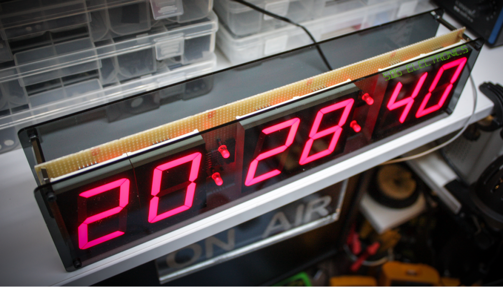 Clock with acrylic front panel